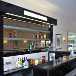 Glass shelves behind bar. Restaurant bar and counter