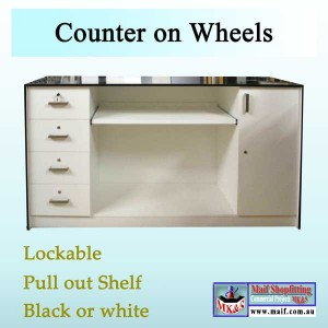 Shop counter movable on wheels