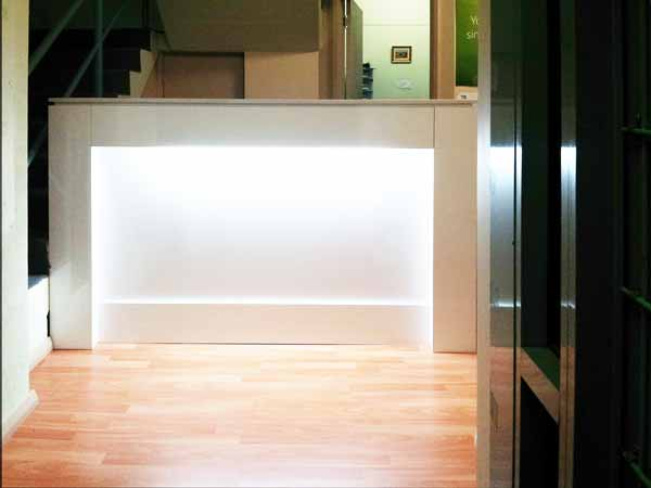 White reception counter with light