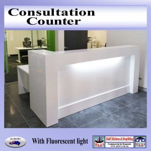 Counter on tiled floor. White gloss with light