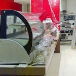 Counter for Cafe, Zebrano supports, Red glass splashback,