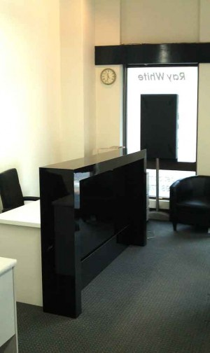 Working office reception counter with shiny black front
