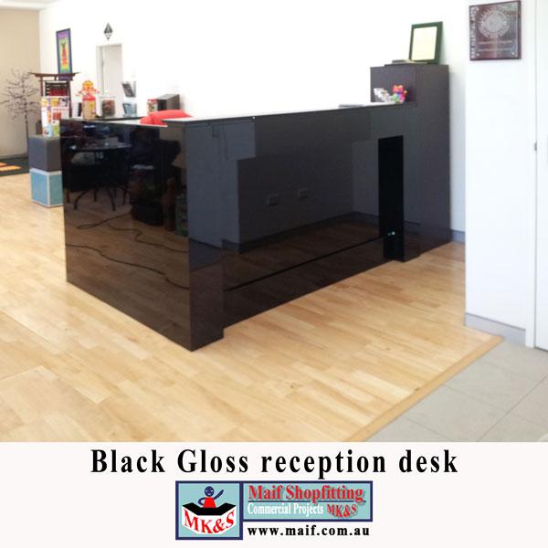 Black gloss reception counter