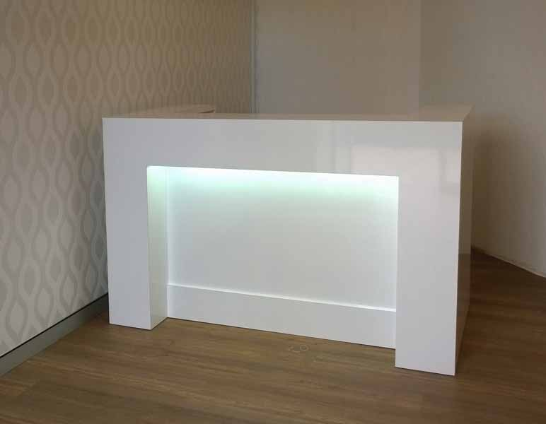 Compact design, White gloss reception desk. With light. Great impact